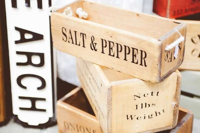 salt and pepper in small wooden boxes